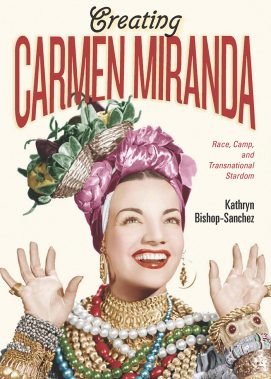 book cover showing Carmen Miranda smiling and hands up, fruitbowl hat of green and pinks